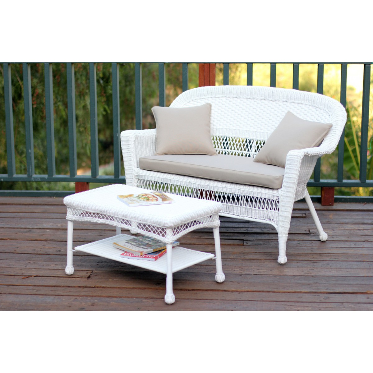 White wicker patio love seat and coffee table set with tan cushion White wicker coffee table