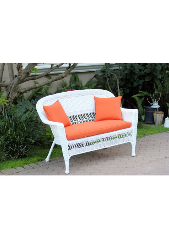 White Wicker Patio Love Seat With Orange Cushion and Pillows