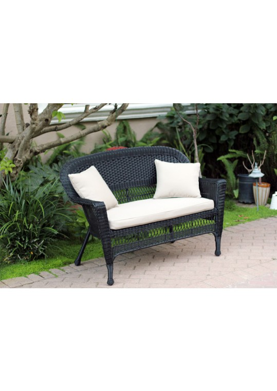 Black Wicker Patio Love Seat With Tan Cushion and Pillows