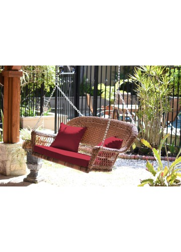 Honey Resin Wicker Porch Swing with Red Cushion