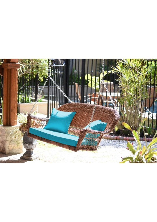 Honey Resin Wicker Porch Swing with Sky Blue Cushion