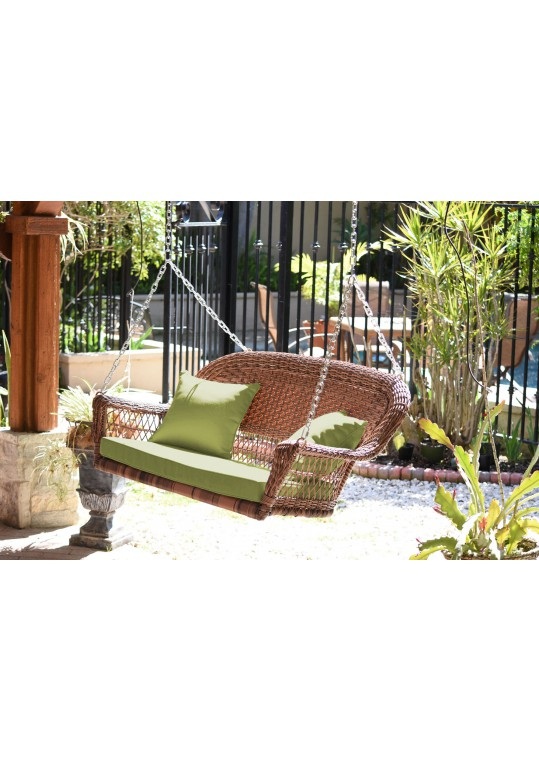 Honey Resin Wicker Porch Swing with Sage Green Cushion