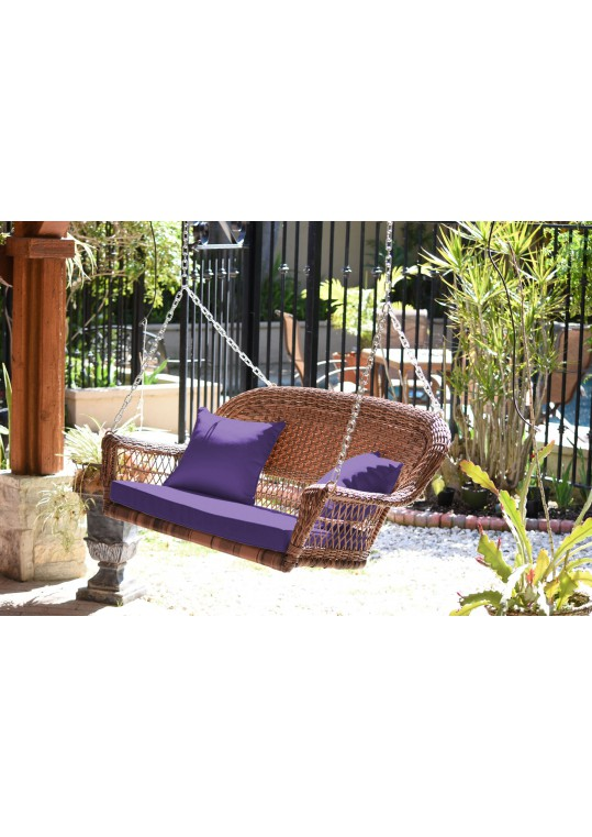 Honey Resin Wicker Porch Swing with Purple Cushion