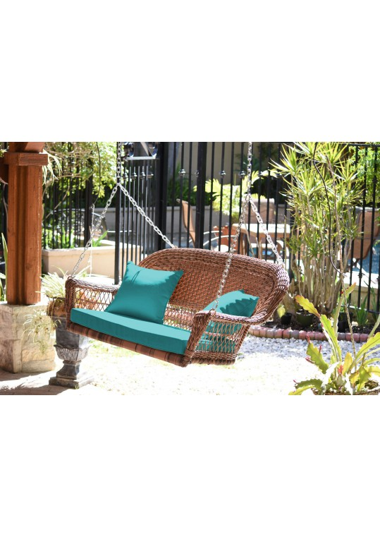 Honey Resin Wicker Porch Swing with Turquoise Cushion