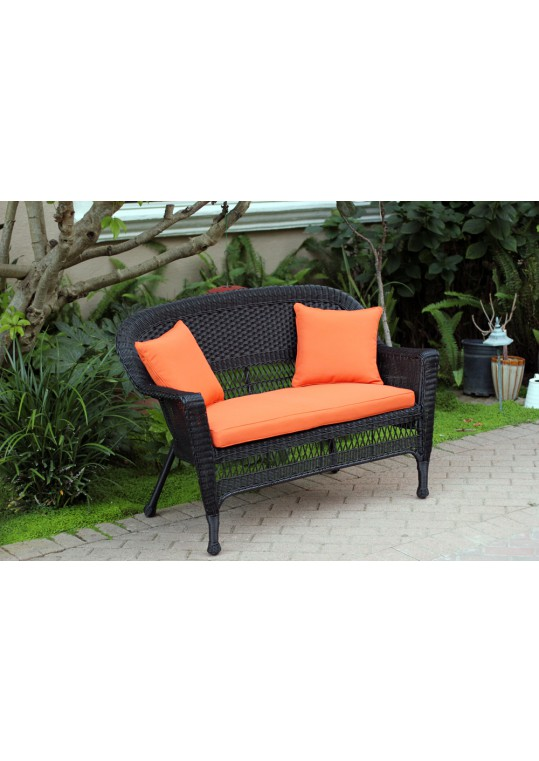 Black Wicker Patio Love Seat With Orange Cushion and Pillows